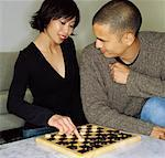 Couple Playing Checkers    Stock Photo - Premium Rights-Managed, Artist: John Lee, Code: 700-00543987