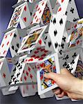 Hand Toppling Card Structure    Stock Photo - Premium Rights-Managed, Artist: Guy Grenier, Code: 700-00544284