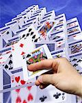 Hand Toppling Card Structure    Stock Photo - Premium Rights-Managed, Artist: Guy Grenier, Code: 700-00544285