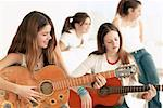 Girls Playing Guitar    Stock Photo - Premium Rights-Managed, Artist: Jerzyworks, Code: 700-00544328
