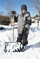 Boy Standing Next to Snow Shovel in Winter    Stock Photo - Premium Rights-Managednull, Code: 700-00546359