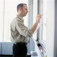 Man Writing on Whiteboard    Stock Photo - Premium Rights-Managednull, Code: 700-00546374