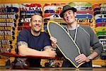 Two Men with Skateboards in Store