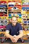 Portrait of Man in Front of Skateboards