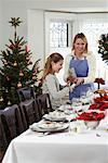Mother and Daughter Setting the Table for Christmas Dinner    Stock Photo - Premium Rights-Managed, Artist: Jerzyworks, Code: 700-00547130
