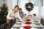 Mother and Daughter Setting the Table for Christmas Dinner    Stock Photo - Premium Rights-Managed, Artist: Jerzyworks, Code: 700-00547131