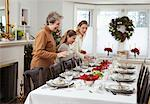 Grandmother, Mother and Daughter Setting Table for Christmas Dinner    Stock Photo - Premium Rights-Managed, Artist: Jerzyworks, Code: 700-00547132