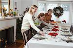 Grandmother, Mother and Daughter Setting Table for Christmas Dinner    Stock Photo - Premium Rights-Managed, Artist: Jerzyworks, Code: 700-00547133