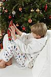 Boy Opening Christmas Present    Stock Photo - Premium Rights-Managed, Artist: Jerzyworks, Code: 700-00547173