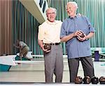 Portrait of Men In Bowling Alley    Stock Photo - Premium Rights-Managed, Artist: Dan Lim, Code: 700-00549129
