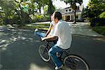 Couple Riding on Bicycle Together, Woman Sitting on Handlebars