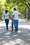 Couple Walking with Bicycle