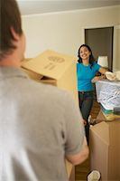 peter griffith - Woman Watching Man Move Boxes On Moving Day    Stock Photo - Premium Rights-Managednull, Code: 700-00550551