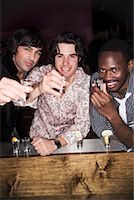Portrait of Men at Nightclub Toasting    Stock Photo - Premium Rights-Managednull, Code: 700-00551307