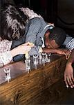 Men Drinking Shots    Stock Photo - Premium Rights-Managed, Artist: Masterfile, Code: 700-00551355