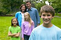 Boy Standing in Front of Family    Stock Photo - Premium Rights-Managed, Artist: Peter Griffith, Code: 700-00551439