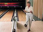Woman Bowling and Cheering    Stock Photo - Premium Rights-Managed, Artist: Dan Lim, Code: 700-00553629