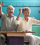 Couple Cheering in Bowling Alley Stock Photo - Premium Rights-Managed, Artist: Dan Lim, Code: 700-00553638