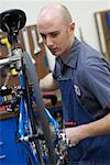 Man Fixing Bike in Shop    Stock Photo - Premium Rights-Managed, Artist: Tim Mantoani, Code: 700-00553872