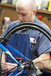 Man Fixing Bike in Shop    Stock Photo - Premium Rights-Managed, Artist: Tim Mantoani, Code: 700-00553874