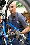 Man Fixing Bike in Shop    Stock Photo - Premium Rights-Managed, Artist: Tim Mantoani, Code: 700-00553876