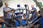 People Fixing Bikes in Shop    Stock Photo - Premium Rights-Managed, Artist: Tim Mantoani, Code: 700-00553877