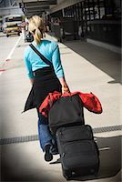 Woman with Luggage at Airport    Stock Photo - Premium Rights-Managednull, Code: 700-00554096