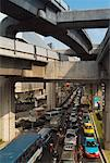 Traffic Under the BTS Skytrain Rails, Bangkok, Thailand    Stock Photo - Premium Rights-Managed, Artist: Pierre Tremblay, Code: 700-00554330