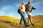 Couple Hiking Through Wildflowers    Stock Photo - Premium Rights-Managed, Artist: Peter Griffith, Code: 700-00554617