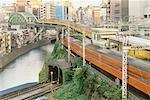Commuter Trains in City, Tokyo, Japan