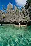 Person Boating, Coron Island, Palawan, Philippines    Stock Photo - Premium Rights-Managed, Artist: Mark Downey, Code: 700-00555356