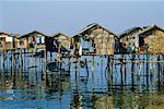 Run Down Houses Above Water, Mindanao, Philippines    Stock Photo - Premium Rights-Managed, Artist: Mark Downey, Code: 700-00555400