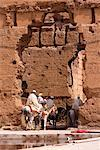 People Riding Horses Through Opening in Wall, Morocco