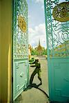 Guard Closing Gate of Royal Palace, Phnom Penh, Cambodia    Stock Photo - Premium Rights-Managed, Artist: Mark Downey, Code: 700-00555800