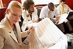 Business People Reading Newspaper    Stock Photo - Premium Rights-Managed, Artist: Mark Leibowitz, Code: 700-00556364