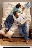 Male Couple Relaxing in Bed    Stock Photo - Premium Rights-Managednull, Code: 700-00557372