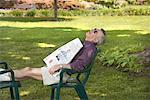Man Sleeping in Backyard