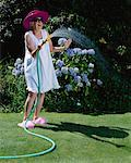 Portrait of Woman Watering Grass    Stock Photo - Premium Rights-Managed, Artist: Noel Hendrickson, Code: 700-00560541