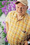 Man Standing Beside Flower Garden    Stock Photo - Premium Rights-Managed, Artist: Roy Ooms, Code: 700-00562297