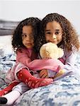 Sisters on Bed    Stock Photo - Premium Rights-Managed, Artist: Tom Feiler, Code: 700-00588938