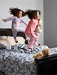 Two Girls Jumping on Bed    Stock Photo - Premium Rights-Managed, Artist: Tom Feiler, Code: 700-00588940