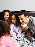 Family in Bed    Stock Photo - Premium Rights-Managed, Artist: Tom Feiler, Code: 700-00588951