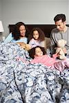 Family in Bed    Stock Photo - Premium Rights-Managed, Artist: Tom Feiler, Code: 700-00588957