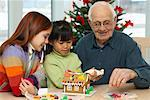 Girls and Senior Decorating Gingerbread House    Stock Photo - Premium Rights-Managed, Artist: Jerzyworks, Code: 700-00589060