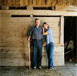 Portrait of Farm Couple in Barn