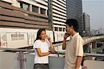 Man and Woman Talking on Cellular Phones    Stock Photo - Premium Rights-Managed, Artist: Brian Sytnyk, Code: 700-00591704