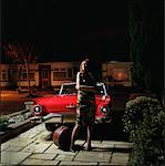 Woman Standing in Driveway at Night    Stock Photo - Premium Rights-Managed, Artist: Michael Clement, Code: 700-00592597