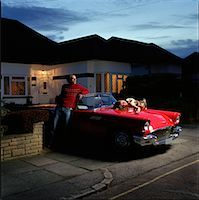 Couple in Driveway with Car    Stock Photo - Premium Rights-Managednull, Code: 700-00592599