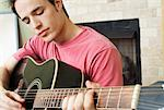 Young Man Playing Guitar    Stock Photo - Premium Rights-Managed, Artist: Artiga Photo, Code: 700-00592742