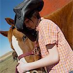 Girl Hugging Her Pet Horse